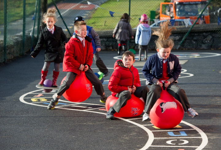 Pupils playing on space hoppers during sos break at Inch N.S. Photograph by John Kelly.